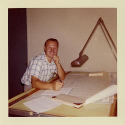 Tony Tyznik in office at table