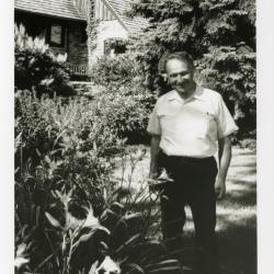 Tony Tyznik outside of house in yard and garden