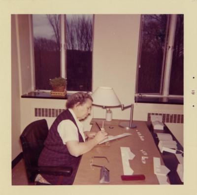 Helen Turner in office at desk
