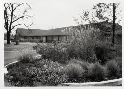 South Farm building and garages, side view