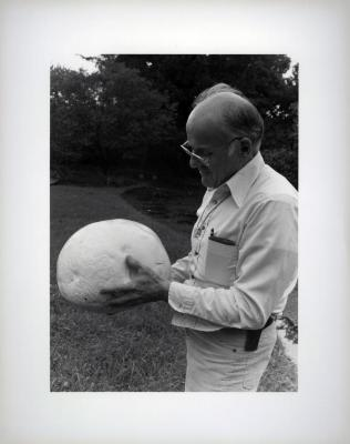 Dick Wason outside with giant puff ball