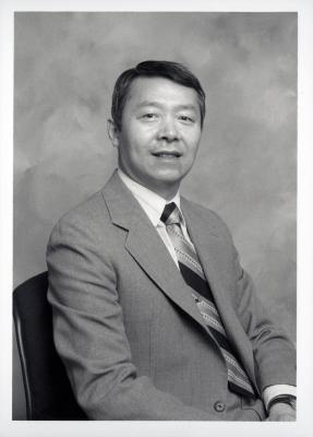 Peter Wang, seated portrait