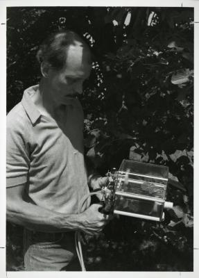 Dr. Gary Watson outside, using Licor photosynthesis system