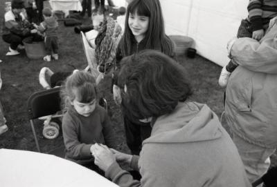 Arbor Day activities at The Morton Arboretum, woman painting girl's hand