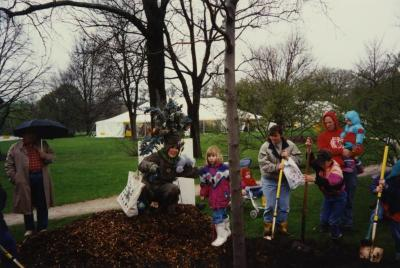 Arbor Day, Carolyn Finzer dressed as Morton Oak with child during tree planting