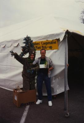 Arbor Day, Carolyn Finzer dressed as Morton Oak and Mike Spravka at the members' cooperative plant pickup tent