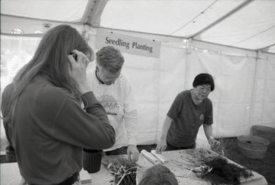 Arbor Day activities at The Morton Arboretum, Tom Simpson and Heidi Tamanaha  working behind Seedling Planting station