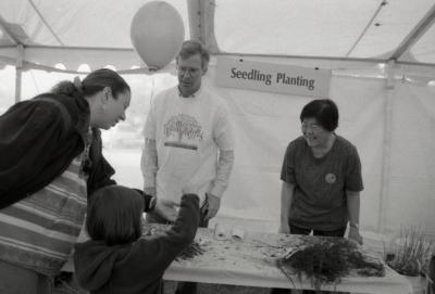 Arbor Day activities at The Morton Arboretum, woman and child at Seedling Planting station