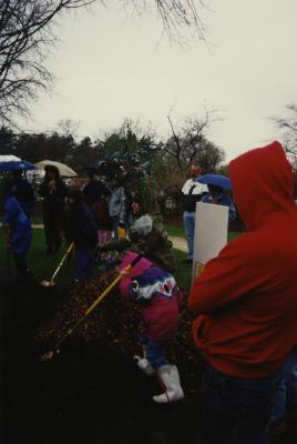 Arbor Day, group watching children and Carolyn Finzer dressed as Morton Oak plant tree