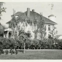 Original South Farm house with high water tank and windmill, built 1917, torn down 1930
