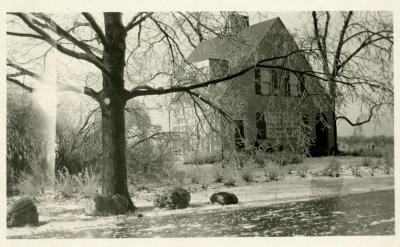 Clarence Godshalk's first Arboretum house, exterior side view of front from frozen Joliet Road, winter