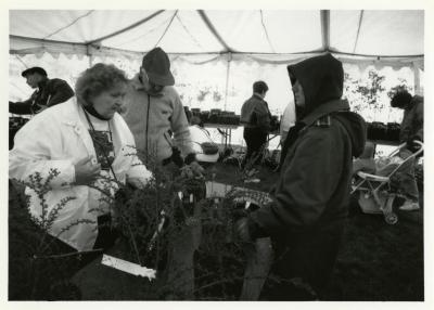 Arbor Day, Lynne Kalata (on the right)  assisting visitors at Surplus Plant Sale
