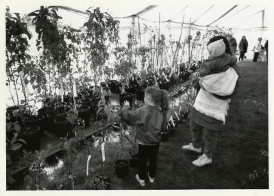 Arbor Day/Week, Surplus Plant Sale, woman and children looking at plants