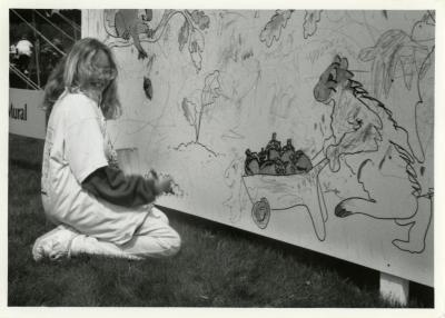 Arbor Day, Whitney Lewis working on mural at the children's art area