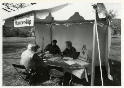 Arbor Day, Mike Cluff and Georgia Rutherford helping a visitor at the membership tent