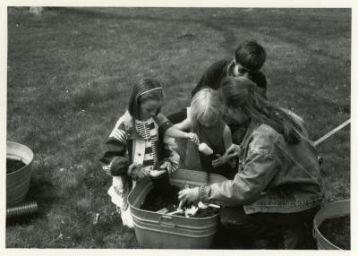 Arbor Day/Week, Rose Rieger planting seeds with children