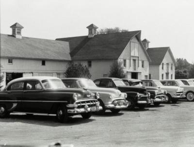 South Farm buildings behind parking lot full of cars