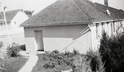 South Farm buildings as they looked before 1935, man working on roof