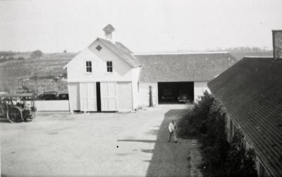 South Farm as it looked before 1935, man walking near building in courtyard