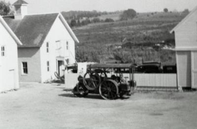 South Farm as it looked before 1935, equipment in courtyard between buildings