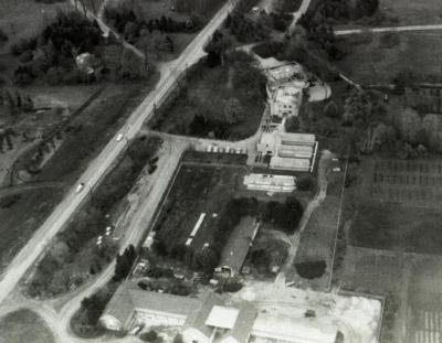 Aerial view of Administration Building, greenhouses, nursery, South Farm