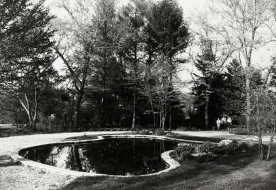 Administration Building lily pond, visitors walking up path