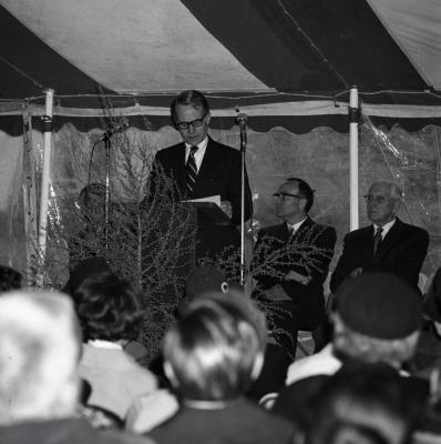 Arbor Day Centennial, tree planting afternoon program, James Olson at podium speaking to seated guests in tent on J. Sterling Morton, founder of Arbor Day