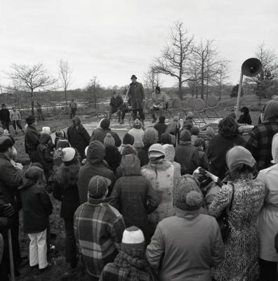 Arbor Day Centennial, tree planting, Marion Hall at microphone speaking to crowd