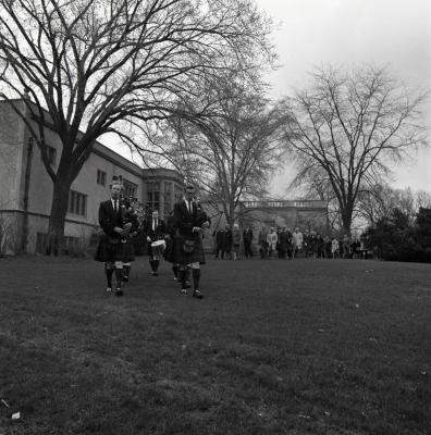 Arbor Day Centennial, tree planting afternoon program, Shannon Rovers pipe band playing bagpipes leading processional from Thornhill across lawn behind Founder's Room