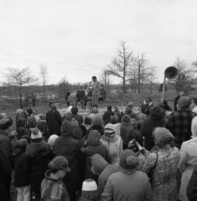 Arbor Day Centennial, tree planting, Webster Crowley at microphone speaking to crowd