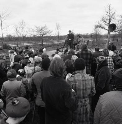 Arbor Day Centennial, tree planting, Tony Tyznik at microphone speaking to crowd