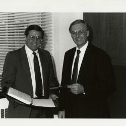 Old business manager, Donald Heldt (left), with new business manager, Timothy Wolkober, in office