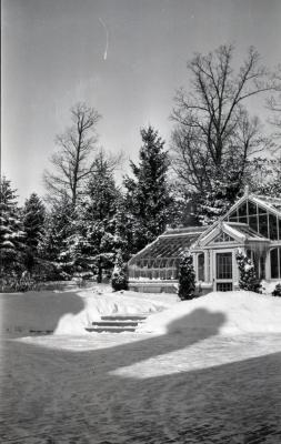 Morton residence brick courtyard and greenhouse in winter