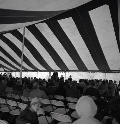 Arbor Day Centennial, afternoon program, Clarence Godshalk at podium speaking to seated guests in tent