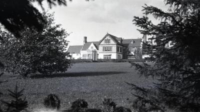 South view across lawn of Morton residence with hedge