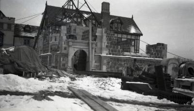 Men working in front of Morton residence library construction in winter