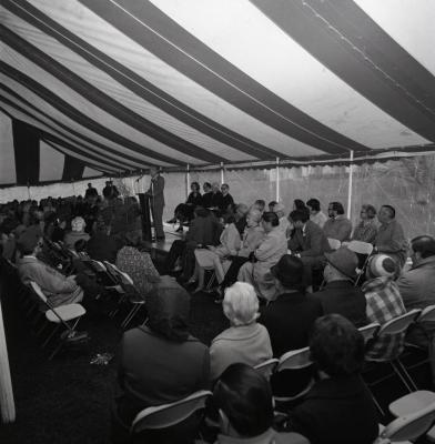 Arbor Day Centennial, afternoon program, Daniel Peterkin Jr. at podium speaking to seated guests in tent