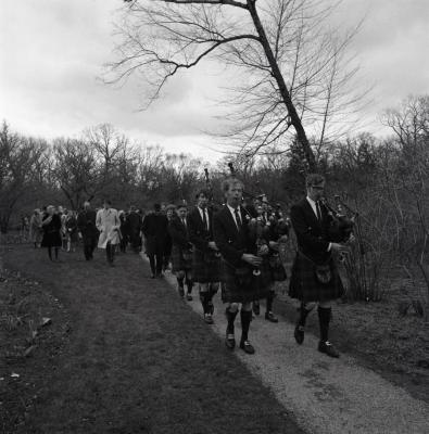 Arbor Day Centennial, afternoon program, Shannon Rovers pipe band playing bagpipes leading processional down path
