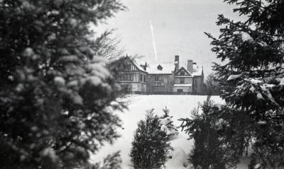 Partial south view of Morton residence in winter