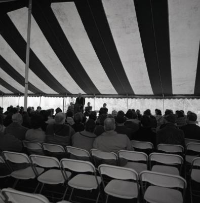 Arbor Day Centennial, afternoon program, Clarence Godshalk at podium speaking to guests seated in tent