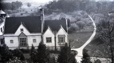 Morton residence library wing and Joy Path from water tower above stone cottage