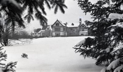 Morton residence and lawn in winter, south view