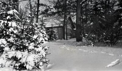 Morton stone cottage on residence grounds in winter